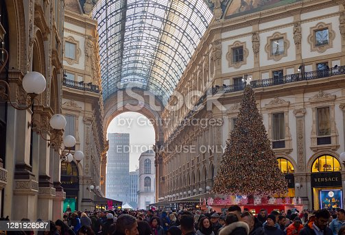 Milano, Italy. The famous Vittorio Emanuele II shopping mall, one of the major landmark in Milan. Christmas time. Crowd of people and tourists. Christmas lights and decorations