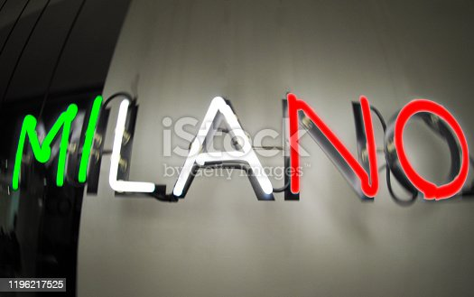 1056445350 istock photo Milano neon sign mounted on a wall 1196217525