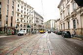 Milan. Italy - May 20, 2019: Milan's Yellow Tram on Magenta Street. Special Tram Line. Street Panorama after Rain.
