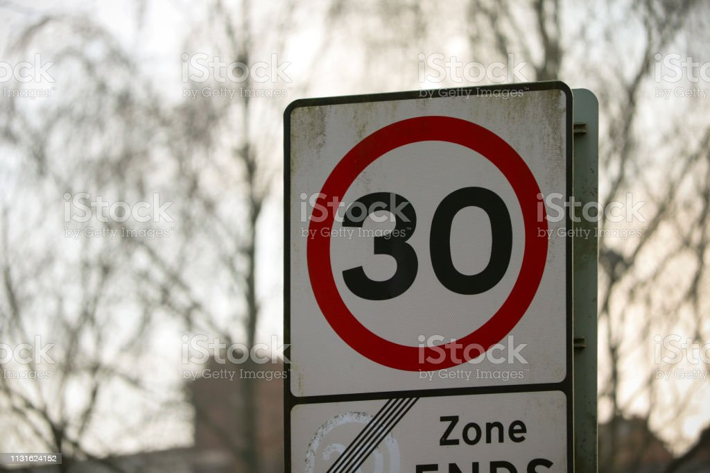 30 Miles A Limit Road Sign - Royalty-free Blue Stock Photo