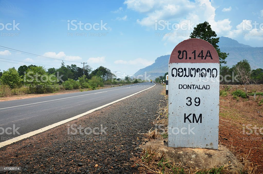 Milestone go to DONTALAD at Pakse in Champasak, Laos stock photo