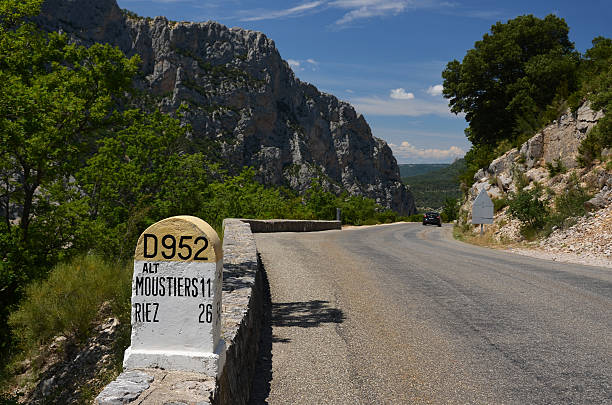 Milestone on narrow road D952 above canyon Verdon stock photo