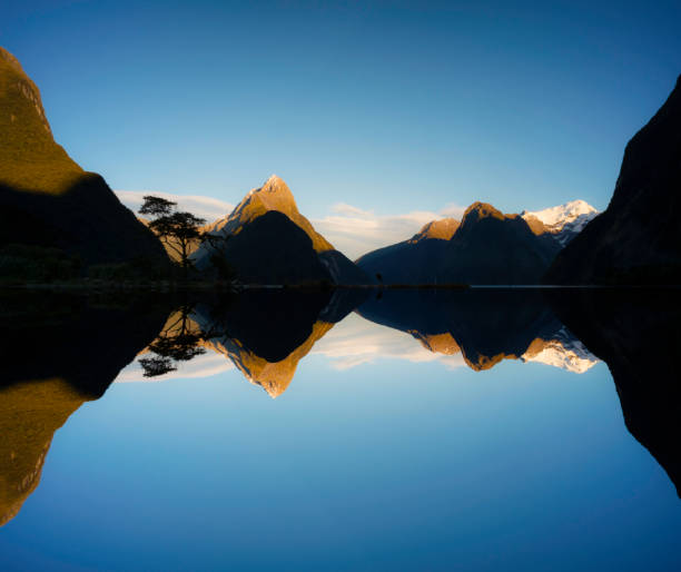 Milford Sound Reflection Composite, New Zealand The spectacular landscape around Mitre Peak and Milford Sound, in the Fiordland National Park on New Zealand's South Island. Composite image. reflection lake stock pictures, royalty-free photos & images