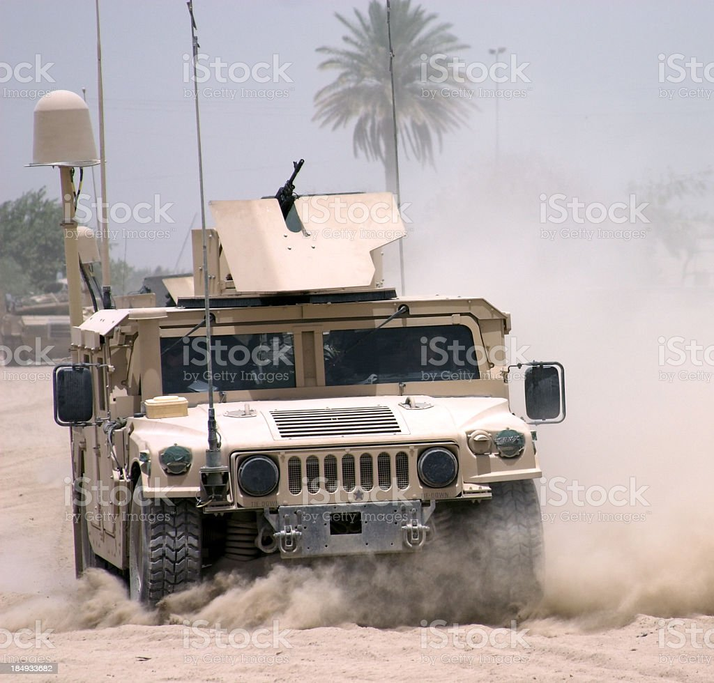 A militaristic vehicle with a mounted gun stock photo