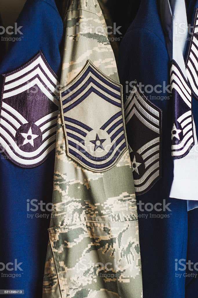 Military Air Force dress and combat uniforms in closet stock photo