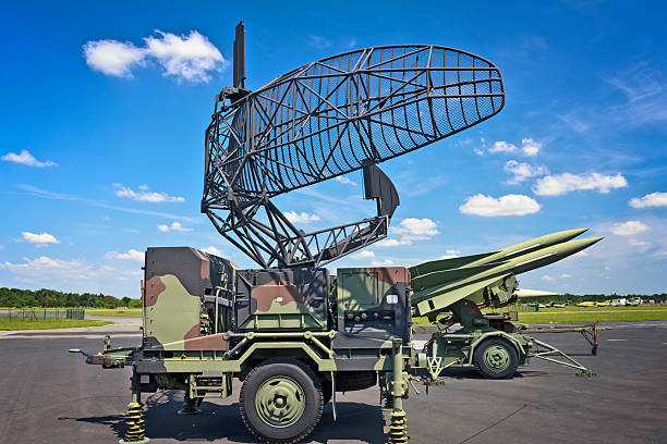 Military air missiles in defense readiness Military Radar Antenna and U.S. medium range self-propelled anti-aircraft missiles MIM-23 Hawk  in defense readiness antiaircraft stock pictures, royalty-free photos & images