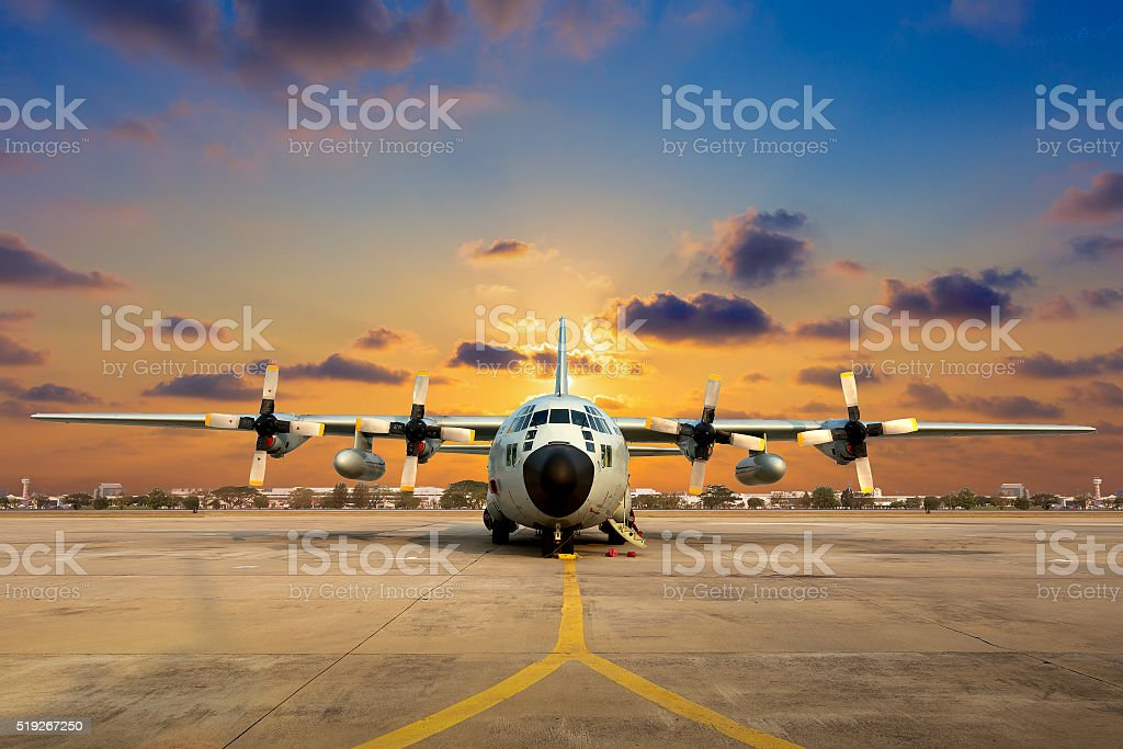 Military aircraft on the runway during sunset. Military aircraft on the runway during sunset. Air Force Stock Photo