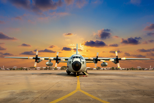 Military Aircraft On The Runway During Sunset Stock Photo - Download Image Now
