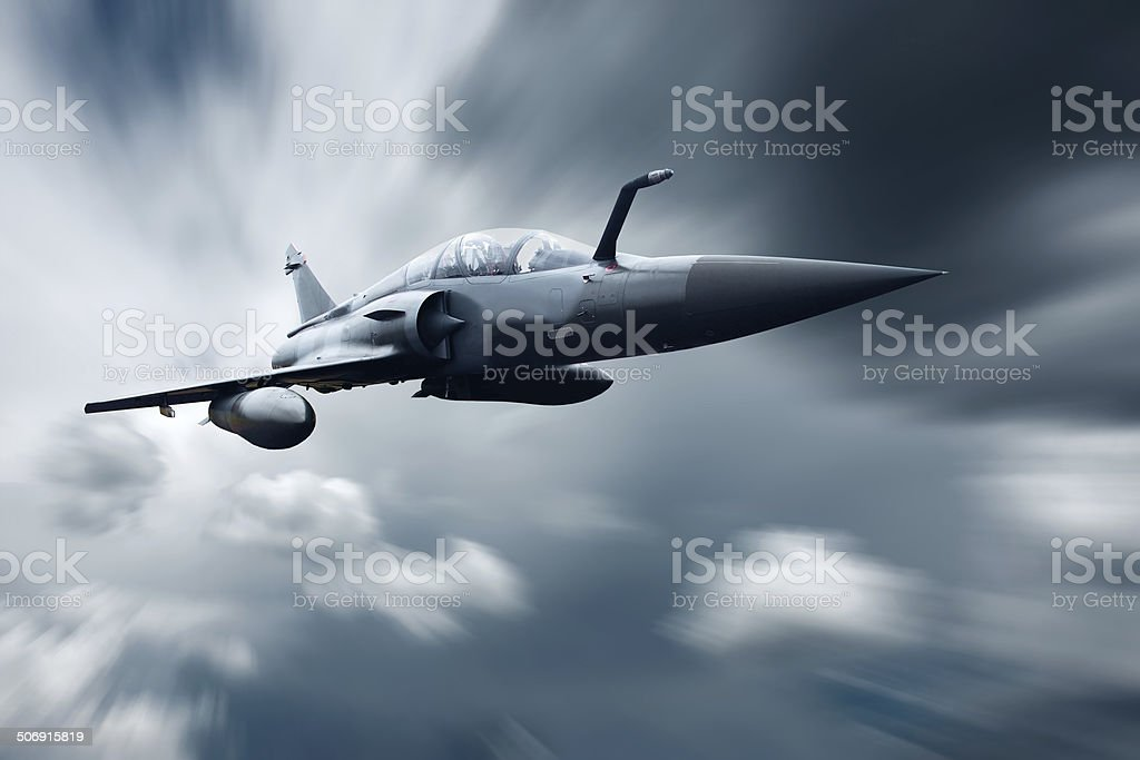 Military airplane at flying on the speed stock photo