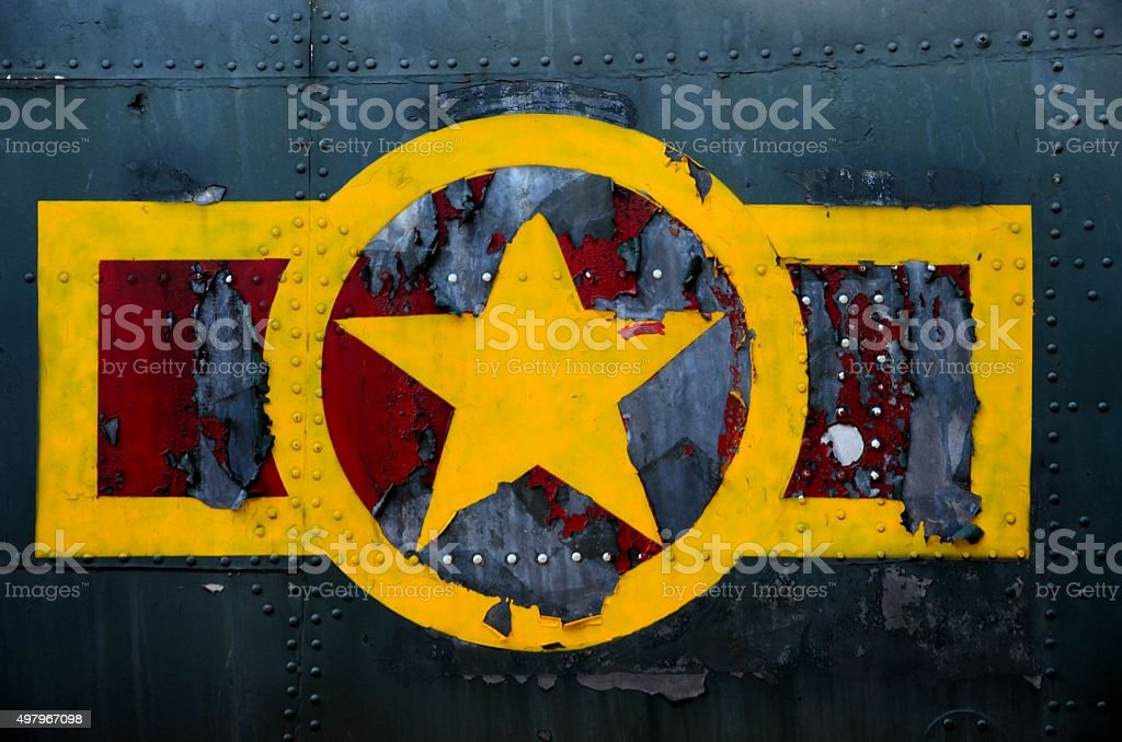 US military airplane fuselage with weathered stars and stripes logo stock photo