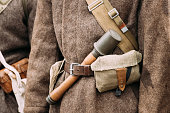Military ammunition of a Red Army Russian Soviet Infantry Soldier at World War II. Soldier's warm cotton wool-padded jacket - Telogreika or vatnik, pouch, rifle.