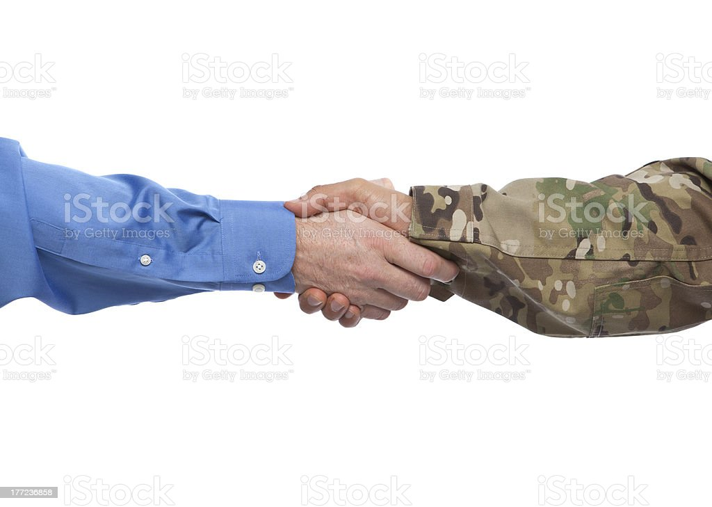 Military and Businessman Handshake stock photo