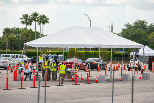 Military and medical personnel setting up to test for Coronavirus Covid 19 in Miami Hard Rock Stadium Parking lot