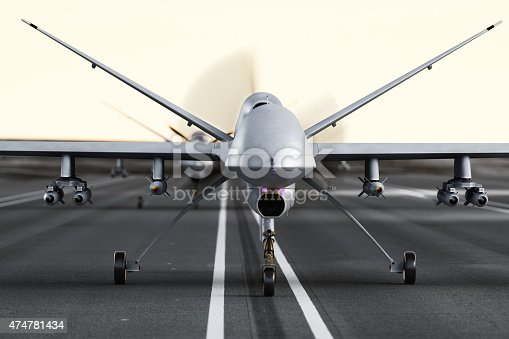 509897009 istock photo Military armed UAV drones preparing for takeoff on a runway. 474781434