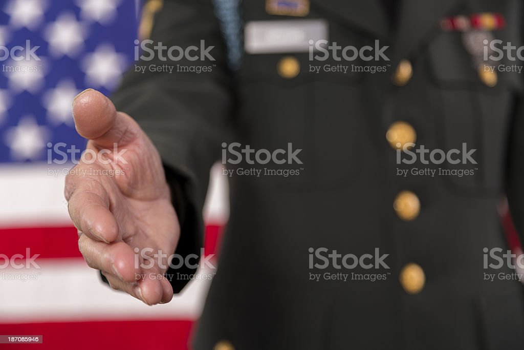 Military.  Army officer reaches out to shake hands. stock photo