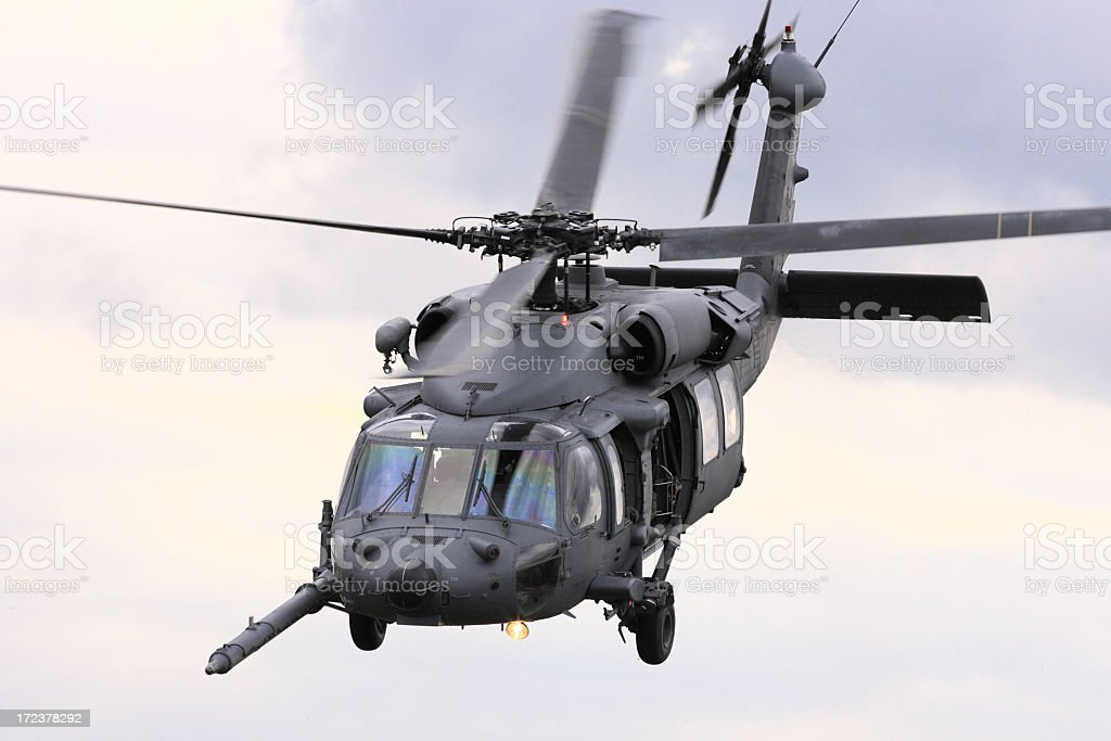 Military attack helicopter flying stock photo