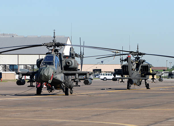 Military attack helicopters Modern military attack helicopters awaiting deployment military base stock pictures, royalty-free photos & images