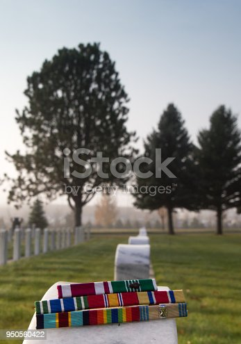 istock Military Award Ribbons Atop a Veteran's Tombstone 950560422