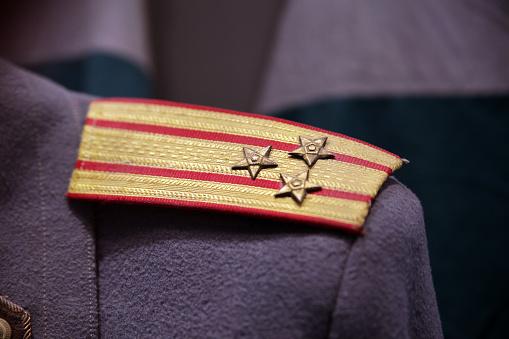 Military badge on vintage style uniform
