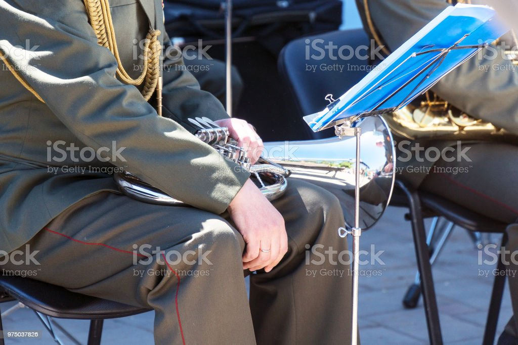 Military band musician with a wind instrument baritone stock photo
