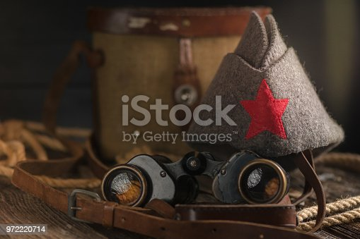 istock Military binoculars and a cap. 972220714