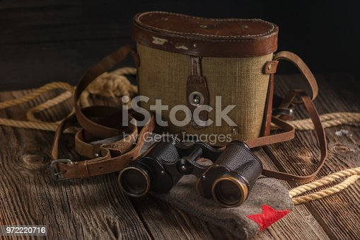 istock Military binoculars and a cap. 972220716