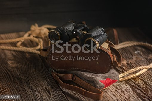 istock Military binoculars and a cap. 972220722