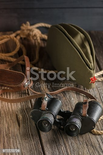 istock Military binoculars and a cap. 972220726