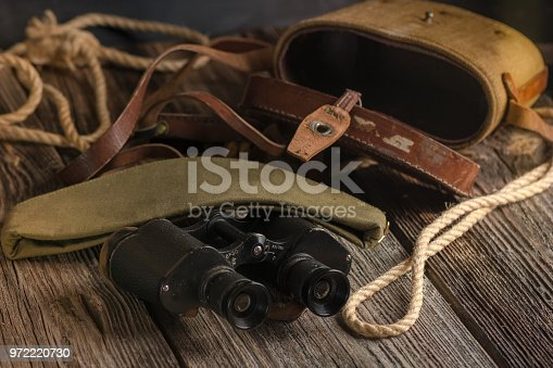 istock Military binoculars and a cap. 972220730
