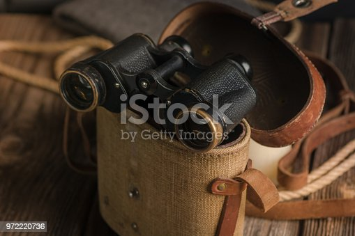 istock Military binoculars and a cap. 972220736