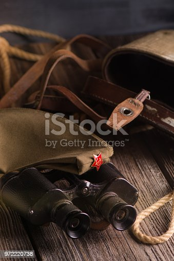 istock Military binoculars and a cap. 972220738