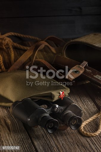 istock Military binoculars and a cap. 972220742