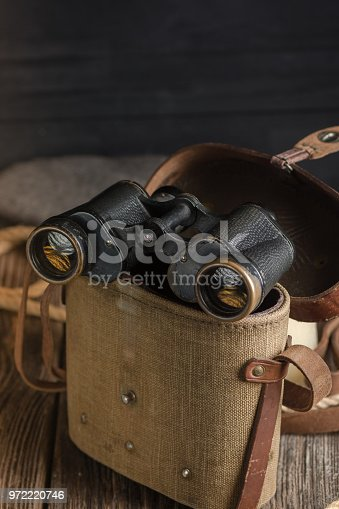 istock Military binoculars and a cap. 972220746