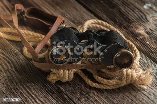 istock Military binoculars and a cap. 972220752