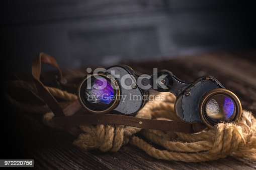 istock Military binoculars and a cap. 972220756