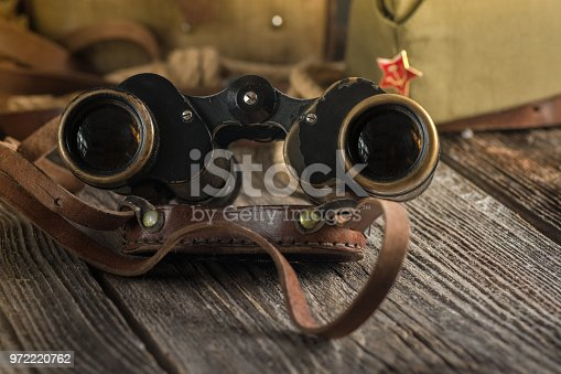 istock Military binoculars and a cap. 972220762