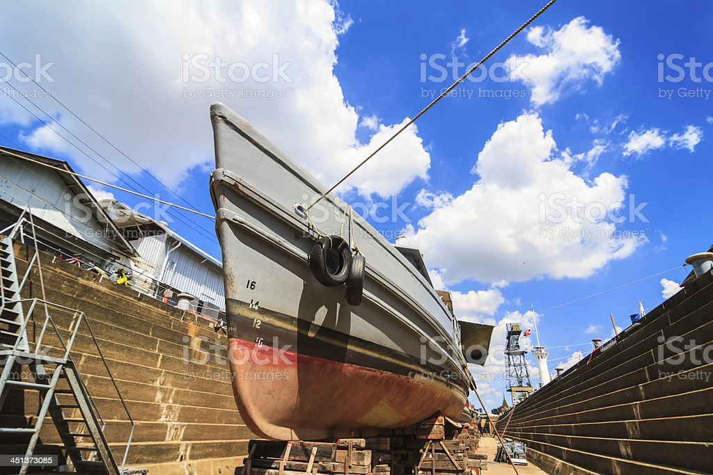 Military boat under repairing in dock yard stock photo