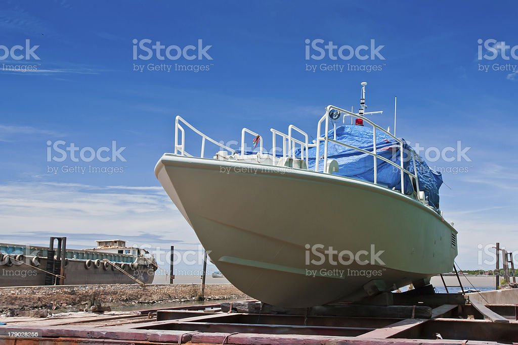 Military boat was repaired in the dry dock stock photo