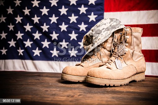 istock USA Military boots, hat and dog tags with flag. 953513188