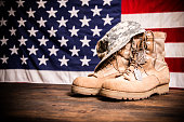 USA Military boots, hat and dog tags with flag.