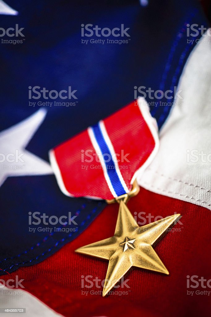 Military Bronze Star Medal on American Flag stock photo