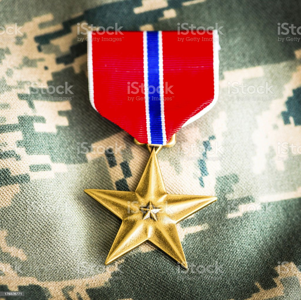 Military Bronze Star Medal on Camouflage Uniform stock photo