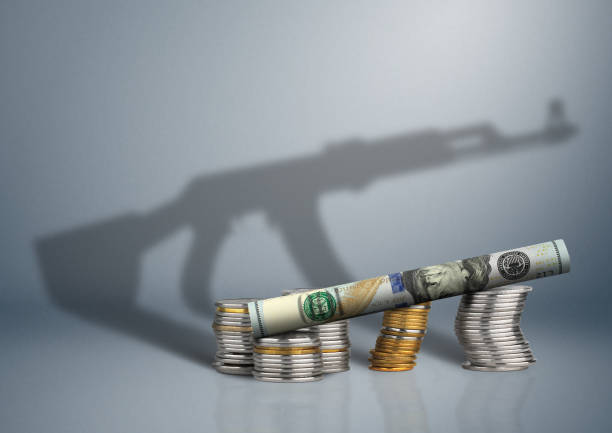 military budget concept, money with gun shadow military budget concept, money with gun shadow terrorism stock pictures, royalty-free photos & images