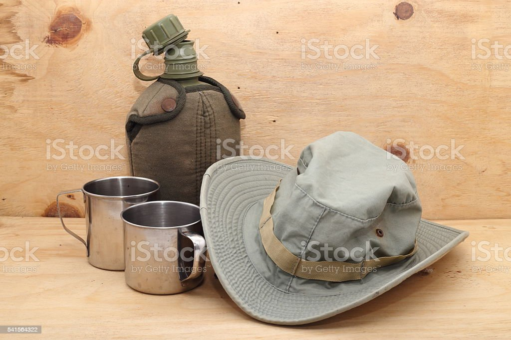Military canteen, Stainless steel cup and Outback safari green hat stock photo
