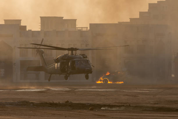 Military combat and war with helicopter landing in the chaos and destruction. Smoke and fire on the ground. Military concept of power, force, strength, air raid. Military combat and war with helicopter landing in the chaos and destruction. Smoke and fire on the ground. Military concept of power, force, strength, air raid. battlefield stock pictures, royalty-free photos & images
