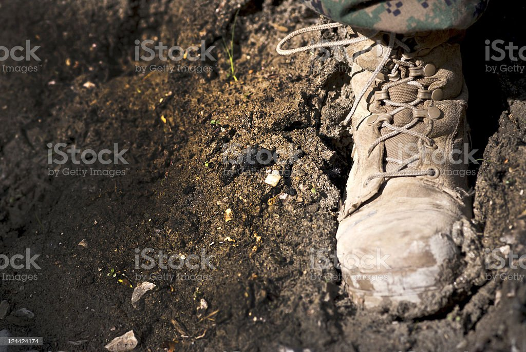 Military Combat Boot on Mud as Copy Space stock photo