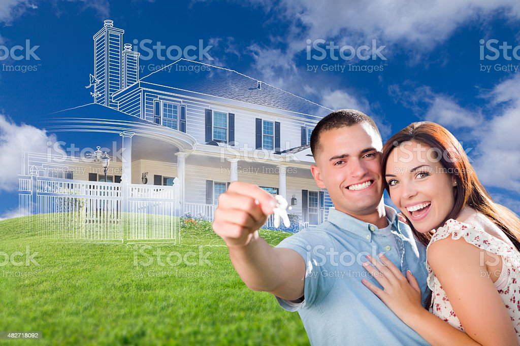 Military Couple Holding House Keys with Ghosted House Drawing Be stock photo