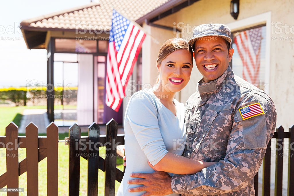 military couple hugging stock photo
