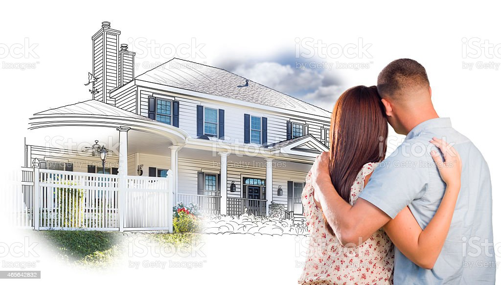 Military Couple Looking At House Drawing and Photo on White stock photo