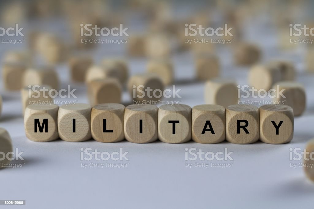 military - cube with letters, sign with wooden cubes stock photo